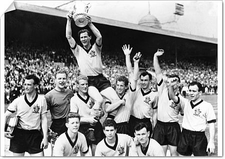 Wolverhampton Wanderers captain Bill Slater holds the FA Cup aloft as he is chaired by his jubilant teammates: (back row, l-r) Gerry Harris, Malcolm Finlayson, Ron Flowers, Peter Broadbent, Eddie Clamp, George Showell, Norman Deeley; (front row