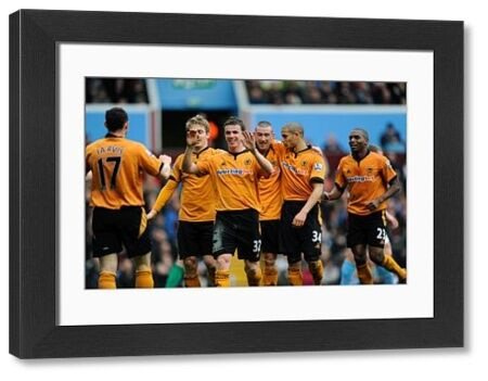 Wolverhampton Wanderers celebrate after an own goal by James Milner of Aston Villa to make it 1-2