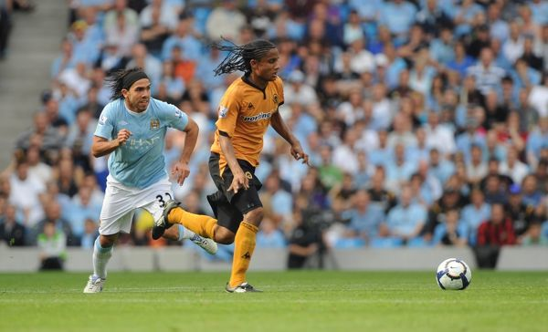 Carlos Tevez of Manchester City chases Michael Mancienne of Wolverhampton Wanderers