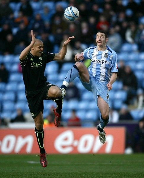 Wolves's Nigel Quashie of (left) competes with Coventry's Guillaume Beuzelin during the Coca Cola Championship match at the Ricoh Arena, Coventry