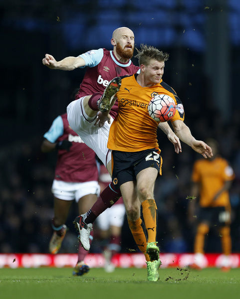 West Ham United's James Collins and Wolverhampton Wanderers' Bjorn Sigurdarson battle for the ball during the Emirates FA Cup, third round game at Upton Park, London