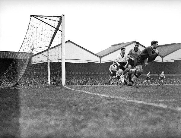 Wolverhampton Wanderers goalkeeper Malcolm Finlayson (r) claims the ball as teammate Eddie Stuart (second r) holds off Darlington's Keith Morton (third r)