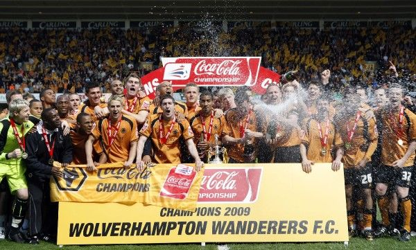 Football - Wolverhampton Wanderers v Doncaster Rovers Coca-Cola Football League Championship - Molineux - 3/5/09 Wolves celebrate promotion with the Championship trophy Mandatory Credit: Action Images / Peter Ford Livepic