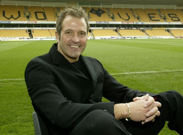 "Steve Bull former Wolves and England striker seated infront of the stand at Molineux that is to be named ""The Steve Bull Stand"" in honour of his 306 goals during a 13 year career at the club"