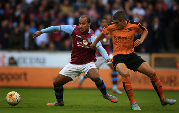 Aston Villa's Gabby Agbonlahor battles for the ball with with Wolves Conor Coady (right) during the pre-season friendly at Molineux, Wolverhampton