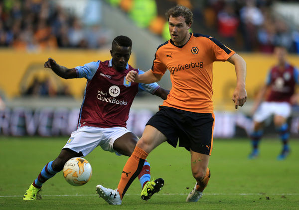 Wolverhampton Wanderers' Kevin McDonald holds off a challenge from Aston Villa's Idrissa Gueye (left) during the pre-season friendly at Molineux, Wolverhampton
