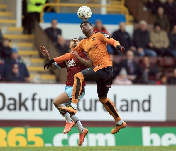 Burnley's Andre Gray (left) and Wolverhampton Wanderers' Kortney Hause battle for the ball during the Sky Bet Championship match at Turf Moor, Burnley. PRESS ASSOCIATION Photo. Picture date: Saturday March 19, 2016. See PA story SOCCER Burnley