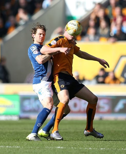 Birmingham's Jonathan Spector and Wolves' Bjorn Sigurdarson (right) battle for the ball during the Sky Bet Championship match at Molineux, Wolverhampton