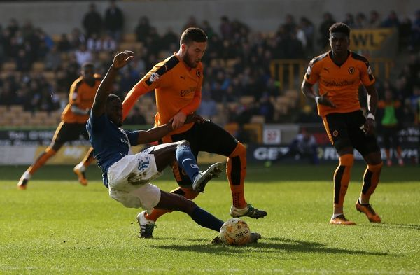 Birmingham's Clayton Donaldson is challenged by Wolves' Matt Doherty in the box during the Sky Bet Championship match at Molineux, Wolverhampton