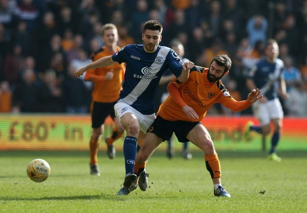 Birmingham's Jon Toral and Wolves' Dominic Iorfa (right) during the Sky Bet Championship match at Molineux, Wolverhampton