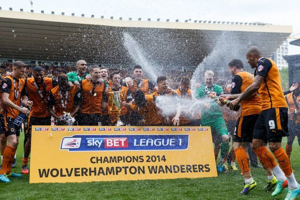Wolverhampton Wanderers' players celebrate their promotion as champions during the Sky Bet League One match at Molineux, Wolverhampton