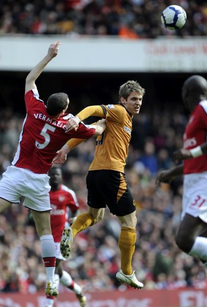 Kevin Doyle of Wolverhampton Wanderers and Thomas Vermaelen of Arsenal