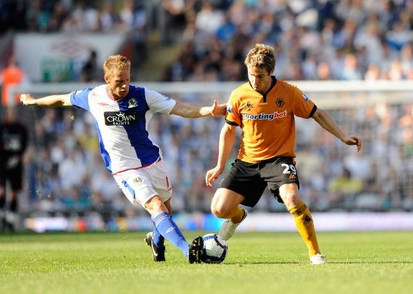 Vince Grella of Blackburn Rovers and Kevin Doyle of Wolverhampton Wanderers
