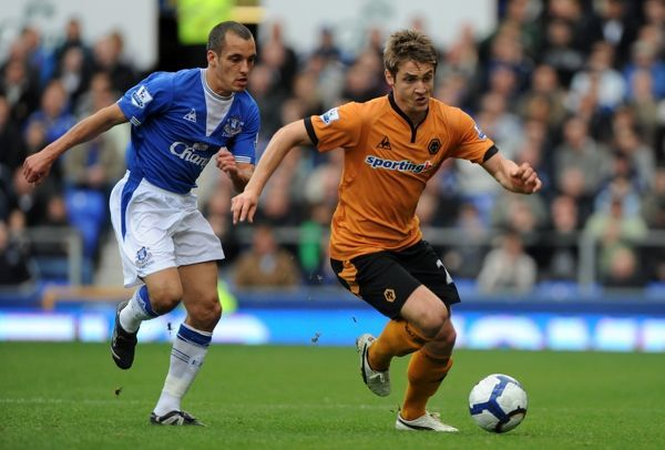 Kevin Doyle of Wolverhampton Wanderers and Leon Osman of Everton