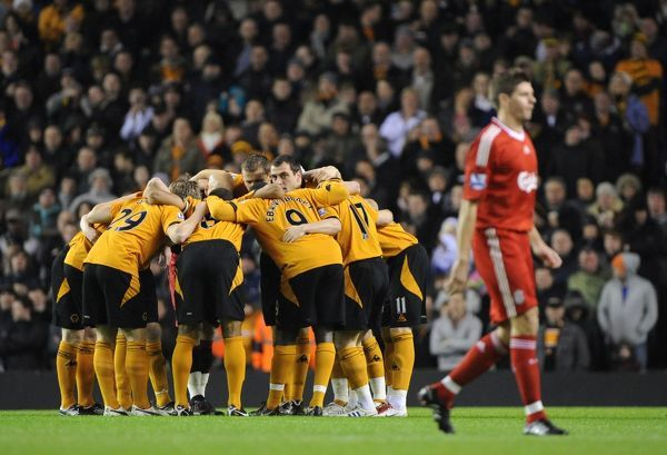 Players of Wolverhampton Wanderers huddle before kick off