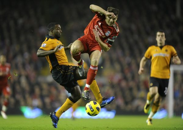 Steven Gerrard of Liverpool and Sylvan Ebanks-Blake of Wolverhampton Wanderers