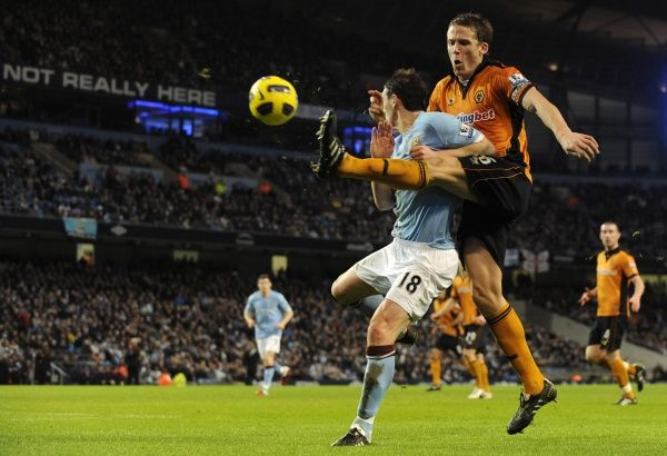 Christophe Berra of Wolverhampton Wanderers and Gareth Barry of Manchester City