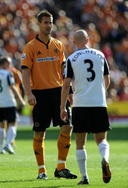 Stefan Maierhofer of Wolverhampton Wanderers stands above Paul Konchesky of Fulham