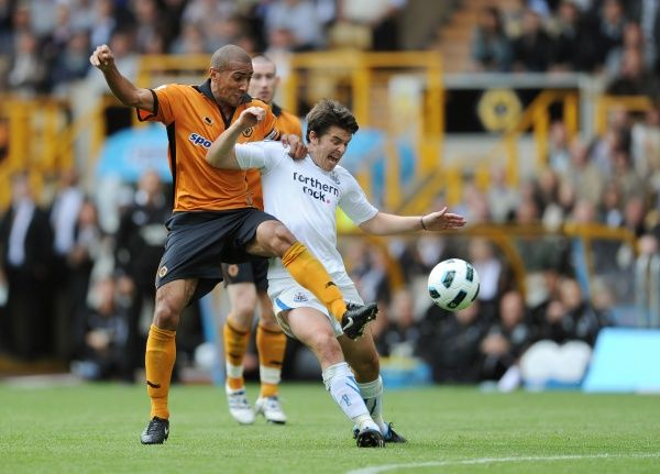 Karl Henry of Wolverhampton Wanderers and Joey Barton of Newcastle United