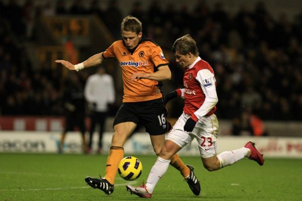 Christophe Berra of Wolverhampton Wanderers and Andrey Arshavin of Arsenal
