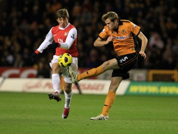Andrey Arshavin of Arsenal and Richard Stearman of Wolverhampton Wanderers