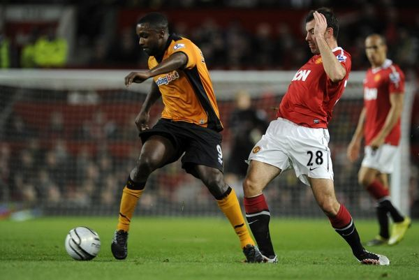 Sylvan Ebanks-Blake of Wolverhampton Wanderers and Darron Gibson of Manchester United