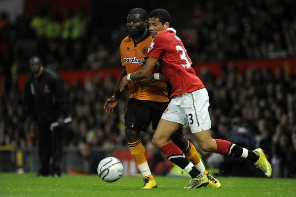 Bebe of Manchester United and George Elokobi of Wolverhampton Wanderers