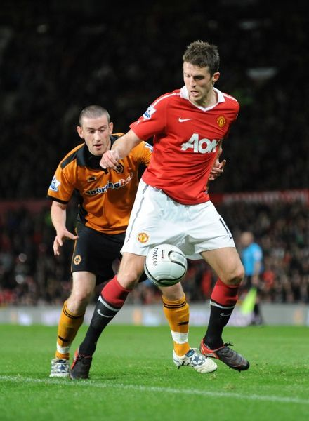 Michael Carrick of Manchester United and David Jones of Wolverhampton Wanderers