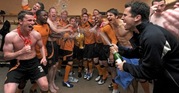 Players of Wolverhampton Wanderers celebrate with the trophy after winning the Coca Cola Football League Championship in the dressing room