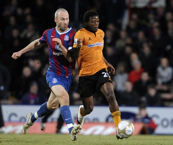 Geoffrey Mujangi Bia of Wolverhampton Wanderers and Shaun Derry of Crystal Palace