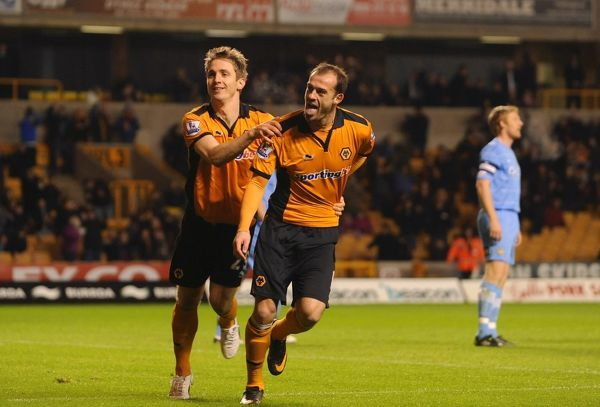 Steven Fletcher of Wolverhampton Wanderers celebrates after scoring to make it 1-0 with Kevin Doyle of Wolverhampton Wanderers