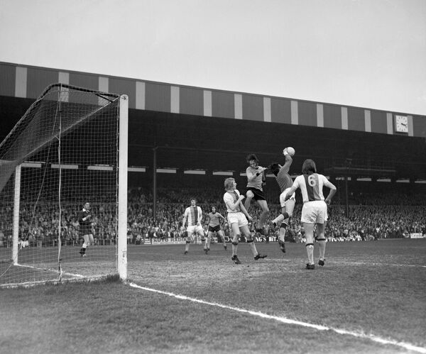 Crystal Palace goalkeeper John Jackson (c) saves well from Wolverhampton Wanderers' Derek Dougan. Also picture (l) is Crystal Palace's Robert Goldthorpe (left of Dougan)