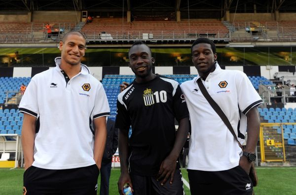 Adlene Guedioura of Wolverhampton Wanderers, Herve Kage of Charleoi and Geoffrey Mujangi Bia of Wolverhampton Wanderers