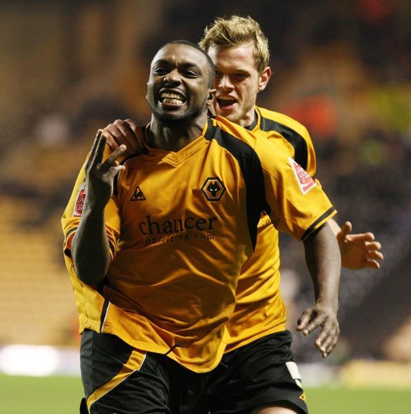 Wolves' Sylvan Ebanks-Blake celebrate his third goal with Richard Stearman (right) during the Coca-Cola Championship match at Molineux, Wolverhampton