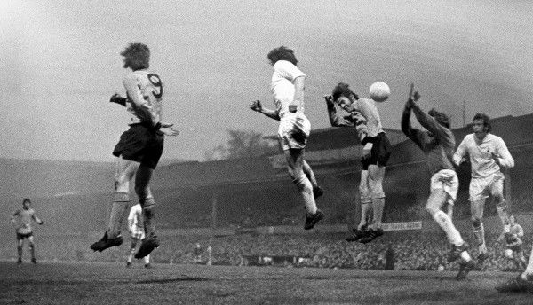Derek Dougan of Wolverhampton Wanderers beats Tottenham Hotspurs centre half Mike England to head goalwards, during the FA Cup final