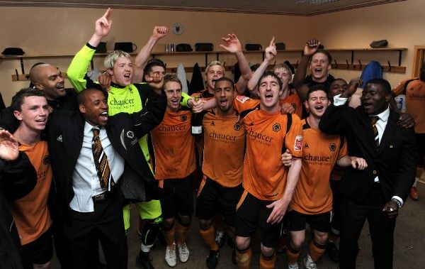 Players of Wolverhampton Wanderers celebrate in the dressing room after winning promotion to the Premier League. Picture: Sam Bagnall/AMA/Wolverhampton Wanderers Pool Picture - copyright Wolverhampton Wanderers