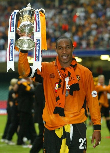 Wolves' captain Paul Ince holds up the trophy after the Nationwide Division One play-off final against Sheffield United at the Millennium Stadium, Cardiff. Wolverhampton Wanderers gained promotion into the Premiership after defeating Sheffield United 3-0
